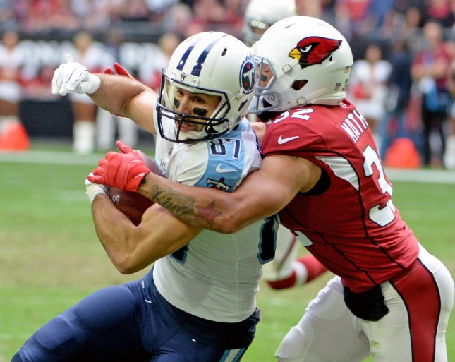 Former Tennessee Titans receiver and current free agent Eric Decker is wrapped up by Arizona Cardinals defensive back Tyrann Mathieu during a game in December. Photo by Art Foxall/UPI