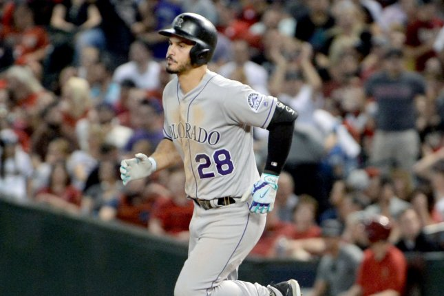 Colorado Rockies infielder Nolan Arenado rounds the bases after hitting a home run in the eighth inning of the National League Wildcard Game against the Arizona Diamondbacks on October 4, 2017 at Chase Field in Phoenix, Arizona. Photo by Art Foxall/UPI