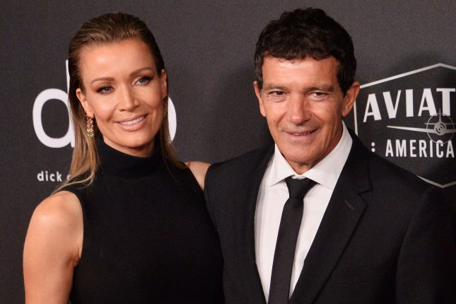 Antonio Banderas (R) poses with his longtime girlfriend Nicole Kimpel. Banderas is nominated for Best Actor at Spain's 34th annual Goya Academy Awards. File Photo by Jim Ruymen/UPI
