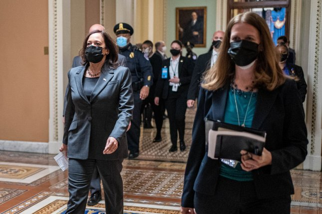 Vice President Kamala Harris walks at the U.S. Capitol on Thursday. Early Friday, she cast a tiebreaker vote to pass a Senate resolution that allows Democrats to pass President Joe Biden's coronavirus relief bill. Photo by Ken Cedeno/UPI