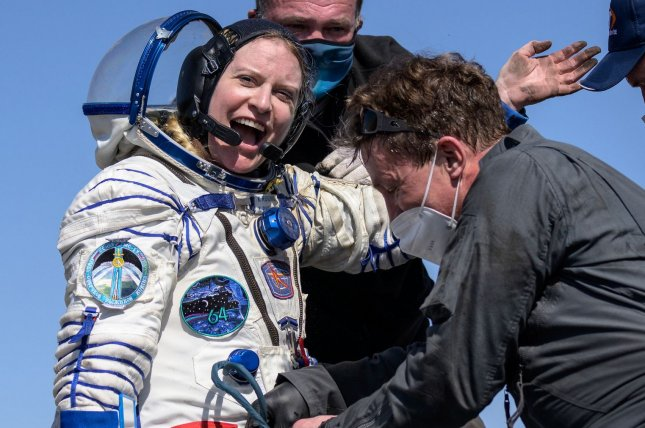 NASA astronaut Kate Rubins is helped out of the Soyuz MS-17 spacecraft just minutes after she and two cosmonauts landed in Kazakhstan on Saturday after 185 days in space aboard the International Space Station. Photo by Bill Ingalls/NASA