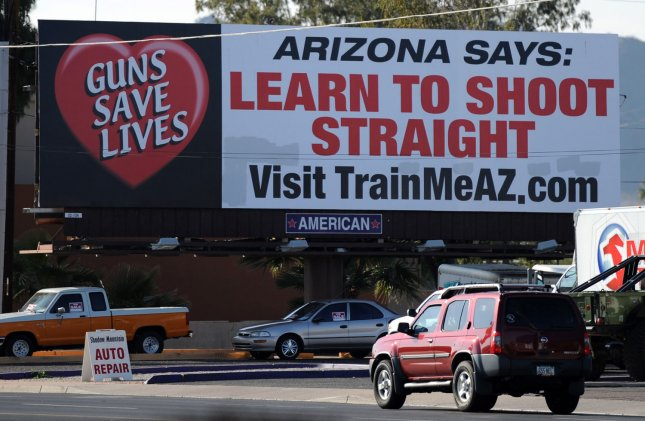 A billboard along 32nd Street in Phoenix is an indication of the attitudes of Arizona residents on gun rights, people of Arizona are allowed to carry guns into bars, January 10,2011. UPI/Art Foxall
