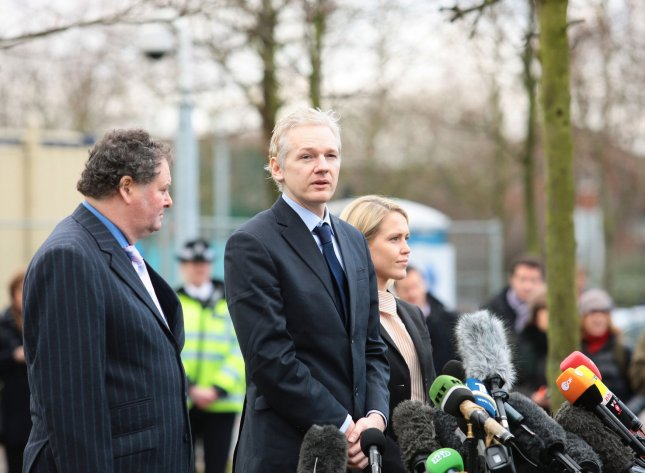 WikiLeaks founder Julian Assange, surrounded by his lawyers Mark Stephens and Jennifer Robinson, speaks to the media after appearing at Belmarsh Magistrates court in Woolwich, Jan. 11, 2011. UPI/Hugo Philpott