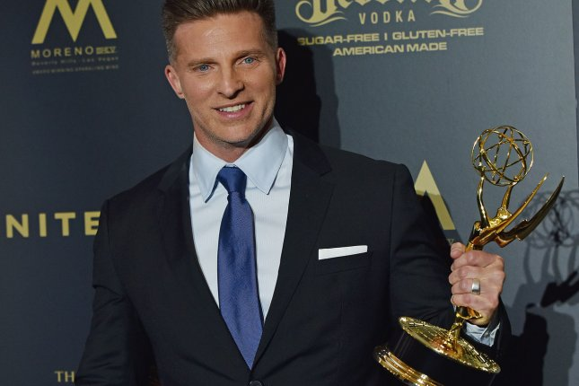 Steve Burton holds up his Daytime Emmy for Outstanding Supporting Actor in a Drama Series backstage in the press room during the 44th Annual Daytime Emmy Awards in Pasadena on April 30. Burton has left The Young and the Restless and is heading back to General Hospital. File Photo by Christine Chew/UPI