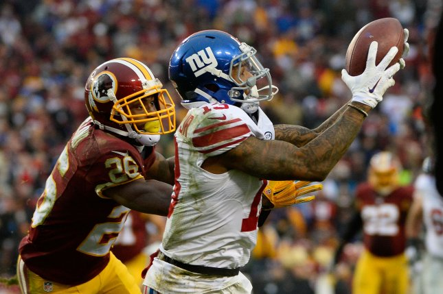 New York Giants wide receiver Odell Beckham (13) makes a long pass reception for a first down in front of Washington Redskins cornerback Bashaud Breeland (26) during the second half on November 29, 2015 at FedEx Field in Landover, Maryland. File photo by David Tulis/UPI