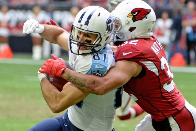 Tennessee Titans wide receiver Eric Decker (L) is wrapped up by Arizona Cardinals defender Tyrann Mathieu after a reception in the second quarter on December 10 at University of Phoenix Stadium in Glendale, Ariz. Photo by Art Foxall/UPI