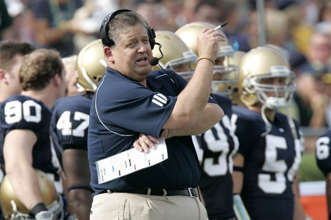Former Notre Dame head coach Charlie Weis stands on the sideline as his team plays Michigan during the second quarter on September 16, 2006 at Notre Dame Stadium in South Bend, Indiana. File photo by Brian Kersey/UPI