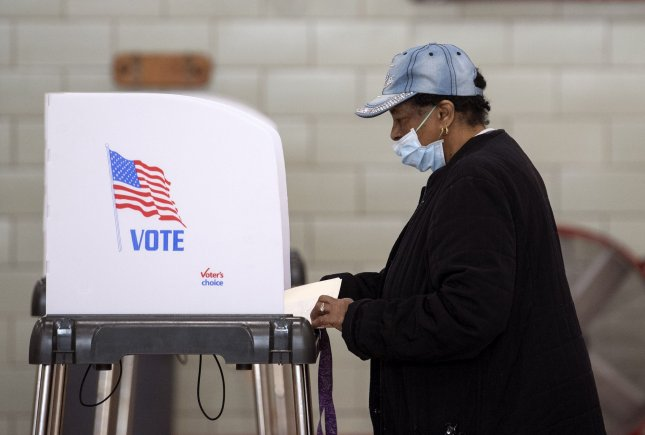 A voter wears a protective mask as they cast their ballot in special election for Maryland's 7th Congressional District to choose a successor to the late Rep. Elijah Cummings, during the COVID-19 pandemic in Baltimore City, Md., on Tuesday. Photo by Kevin Dietsch/UPI