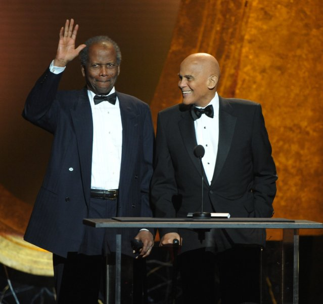 Presenters Sidney Poitier (L) and Harry Belafonte speak onstage during the 43rd NAACP Image Awards held at the Shrine Auditorium in Los Angeles on February 17, 2012. UPI/Jim Ruymen