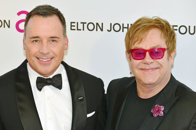 Elton John (R) and David Furnish arrive to host the singer's AIDS Foundation Academy Awards Viewing Party at West Hollywood Park in Los Angeles on February 24, 2013. UPI/Chris Chew