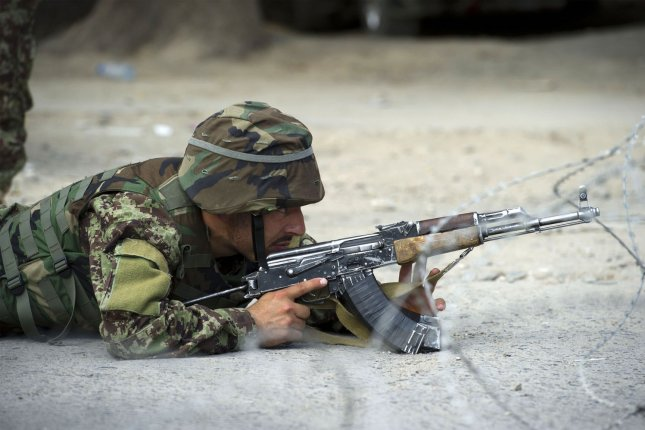 An Afghan soldier takes position near a building occupied by Taliban militants in Kabul, Afghanistan, on Sept. 13, 2011. On Dec. 8, 2015, at least nine Taliban fighters, heavily armed and wearing suicide vests, attacked the Kandahar airport, causing several casualties. File photo by Enayat Asadi/ UPI