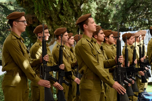 Israeli soldiers stand at attention at the state memorial ceremony marking 10 years since the Second Lebanon War at the Mount Herzl military cemetery in Jerusalem on July 19. The Second Lebanon War between Israel and Hezbollah was fought from July 12 - Aug. 14, 2006. File Photo by Debbie Hill/UPI