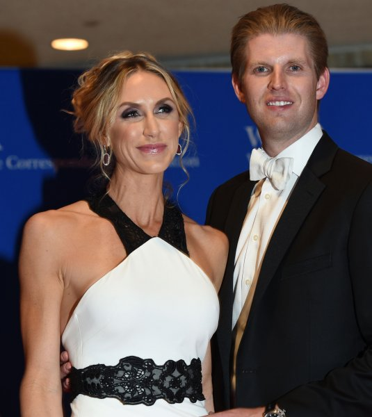 Eric Trump and his wife Lara Yunaska pose on the red carpet prior to the White House Correspondents Association Dinner in April. She appeared at the opening of her father-in-law's North Carolina campaign headquarters on Wednesday. File Photo by Molly Riley/UPI
