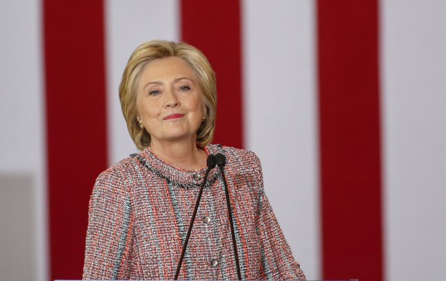 Democratic Presidential candidate Hillary Clinton smiles as she begins her speech at a campaign stop at UNC-Greensboro in Greensboro, North Carolina on September 15, 2016. Returning to the state Thursday after three days off, reportedly recovering from pneumonia, Clinton said millions of Americans aren't as fortunate to be able to afford time off of work. Photo by Nell Redmond/UPI