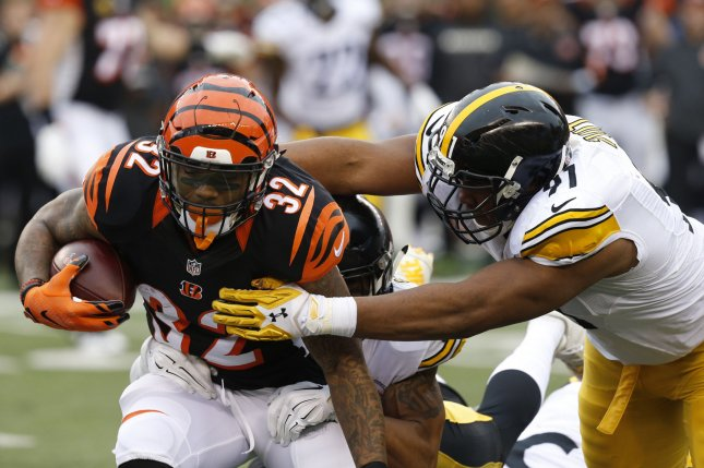 Cameron Heyward brings down Jeremy Hill during first half of play at Paul Brown Stadium. Without Heyward, the Dolphins and Patriots ran all over the Steelers' Defense. Photo by John Sommers II/UPI