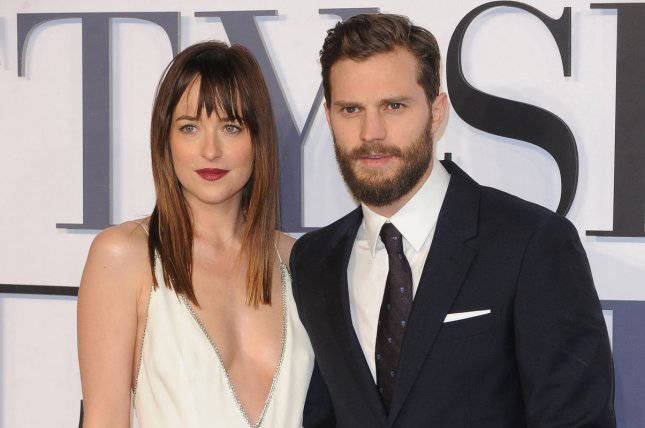 Jamie Dornan (R) and Dakota Johnson at the London premiere of Fifty Shades of Grey on February 12, 2015. File Photo by Paul Treadway/UPI