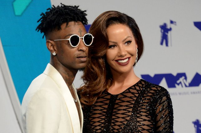 Amber Rose (R) and 21 Savage attend the MTV Video Music Awards on August 27. The television personality hosted her third annual SlutWalk in Los Angeles on Sunday. File Photo by Jim Ruymen/UPI