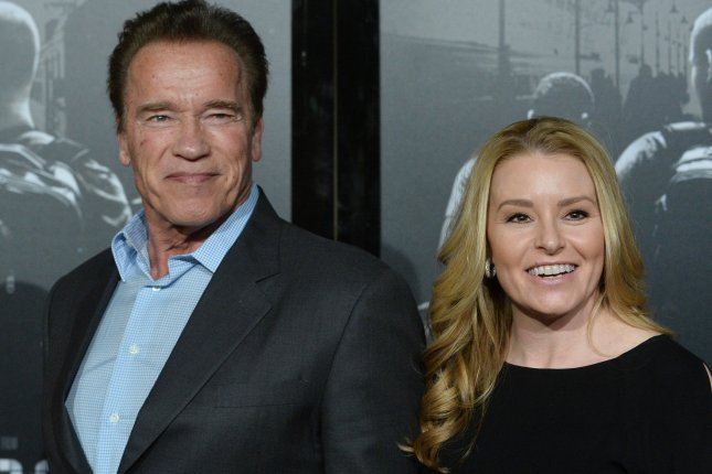 Arnold Schwarzenegger (L) pictured here with Heather Milligan, will star in new Amazon series Outrider set during the 1800s. File Photo by Jim Ruymen/UPI