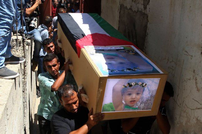 Palestinian mourners carry the bodies of 23-year-old Enas Khammash and her 18-month-daughter Bayan, during their funeral in Deir Al-Balah in the central Gaza Strip on Thursday. Photo by Ismael Mohamad/UPI