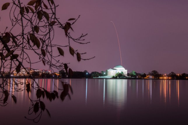The Northrop Grumman Antares rocket, with Cygnus resupply spacecraft onboard, is seen above the Thomas Jefferson Memorial in Washington, D.C., on Saturday. The rocket launched from NASA's Wallops Flight Facility in Virginia. NASA Photo by Aubrey Gemignani/UPI