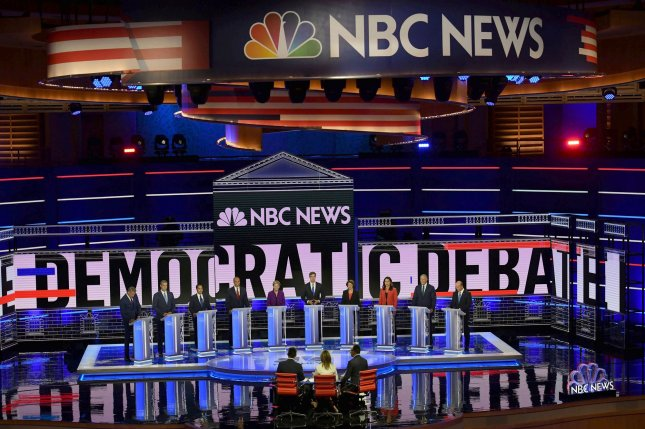 Democratic presidential primary candidates stand before moderators at the Knight Concert Hall in Miami, Fla., on June 26. Photo by Gustavo Cabellero/NBC News/MSNBC/Telemundo/UPIO/UPI