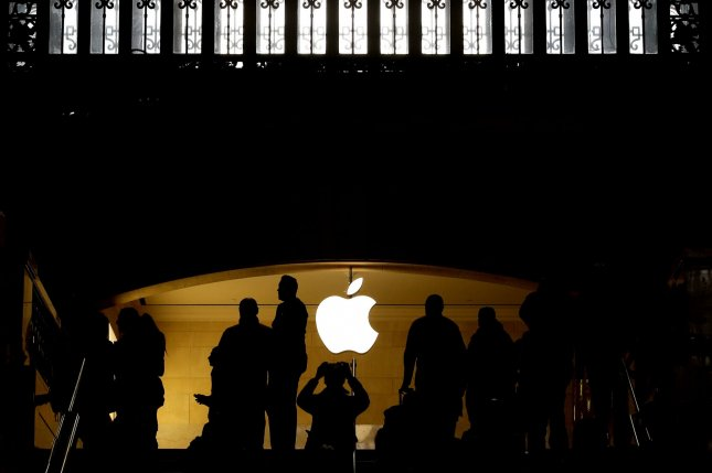 People gather around by the Apple brand logo near the Apple Store in Grand Central Station in New York City on October 25, 2016. U.S. Apple's (AAPL) September-quarter earnings are due out after the market closes today. Photo by John Angelillo/UPI