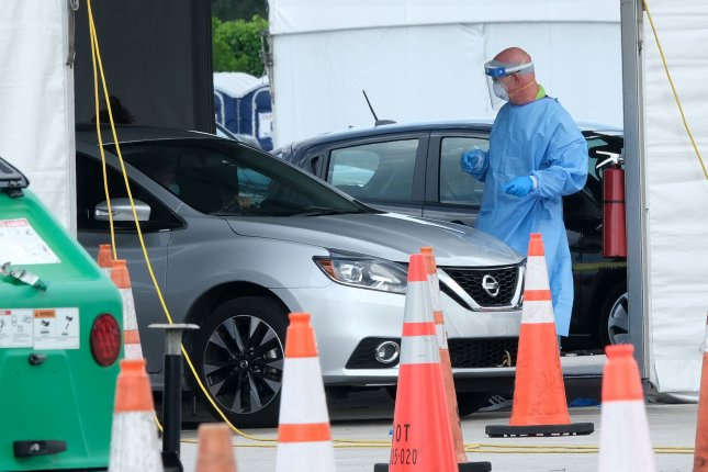 Residents in Miami, Fla., drive into a COVID-19 testing area at Hard Rock Stadium on July 2. Florida reported a surge of 10,000 cases on Sunday and is one of the states with the fastest growing number of coronavirus cases. Photo by Gary I Rothstein/UPI