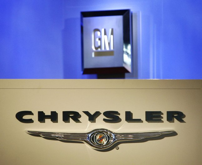 Logos for Chrysler and General Motors are seen at the North American International Auto Show at the Cobo Center on January 11, 2009 in Detroit, Michigan. Despite rumors of a possible merger with GM, Chrysler CEO Bob Nardelli says the automaker's white-collar staff cuts are not a sign that the company is preparing itself for sale. (UPI Photo/Brian Kersey)