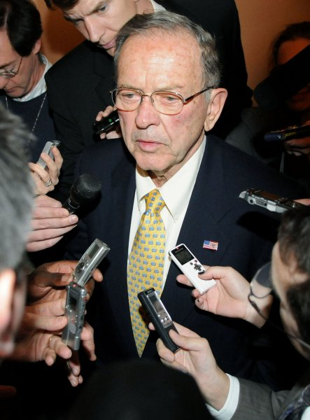Sen. Ted Stevens (R-AK) is questioned by members of the media as he walks to a Republican caucus meeting on Capitol Hill in Washington on November 18, 2008. Stevens' Republican colleagues have postponed a vote on whether to keep him in their conference, opting to wait until his Senate race in Alaska is resolved. (UPI Photo/Kevin Dietsch)