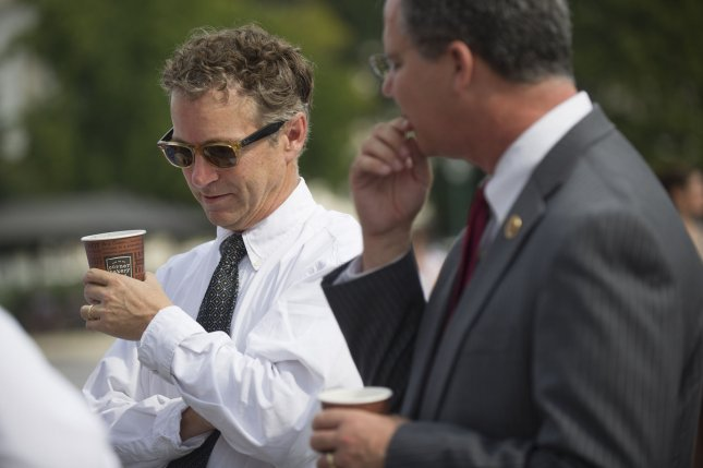 Sen. Rand Paul (R-KY) (L) and Rep. Brett Guthrie (R-KY) drink coffee on the front steps of the U.S. Capitol in Washington, D.C. on October 3, 2013. Senator Paul invited members for coffee and to talk about a way to end the government shutdown. . UPI/Kevin Dietsch