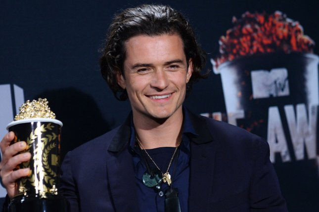 Actor Orlando Bloom appears backstage with the award he won for Best Fight - The Hobbit: The Desolation of Smaug at the MTV Movie Awards at Nokia Theatre L.A. Live in Los Angeles, California on April 13, 2014. UPI/Jim Ruymen