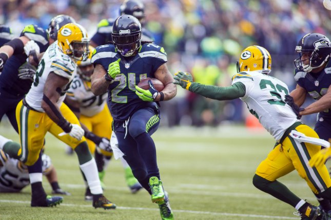 Seattle Seahawks running back Marshawn Lynch (24) rushes for a 24-yard touchdown against the Green Bay Packers during the NFC Championship game at CenturyLink Field in Seattle, Washington on January 18, 2015. The Seattle Seahawks beat the Green Bay Packers in overtime 28-22 for the NFC Championship Seattle. Photo by Jim Bryant/UPI