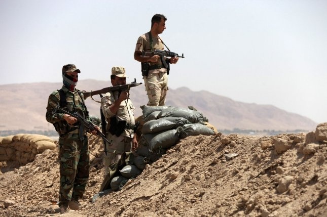 Kurdish Peshmerga soldiers take up position Aug. 28, 2014, in Makhmur town, northwest of Erbil, Kurdistan region, Iraq. U.S. Defense officials said reports the Islamic State used chemical weapons against Kurdish fighters are credible. File photo by Mohammed al Jumaily/UPI