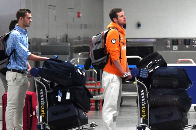 USA Olympic swimmer Gunnar Bentz (L) and Jack Conger arrive at Miami International airport from Rio de Janeiro with airport security Friday, August 19, 2016. Conger and Gunnar Bentz were held in Rio pending an investigation that they had been held up and victims of an armed robbery. Photo by Gary I Rothstein/UPI