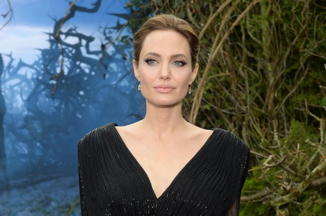 After Angelina Jolie's mastectomies, there was a spike in BRCA gene testing for heightened risk of cancer, but no corresponding rise in mastectomy rates.. Pictured, Jolie attends the screening of Maleficent at the Kensington Palace in London on May 8, 2014. File photo by Rune Hellestad/UPI