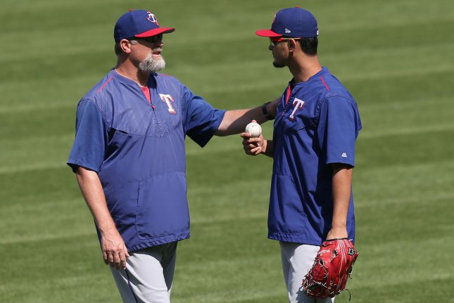 Texas Rangers pitching coach Douglas Brocail (L) talks with Yu Darvish prior to their game against the Cleveland Indians on June 29 at Progressive Field in Cleveland, Ohio. Photo by Aaron Josefczyk/UPI