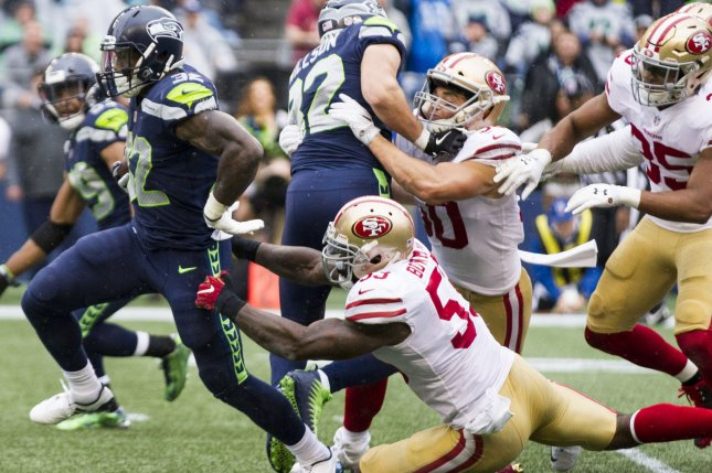 Seattle Seahawks running back Chris Carson (32) breaks the attempted tackle by San Francisco 49ers middle linebacker NaVorro Bowman (53) on Sunday at CenturyLink Field in Seattle, Wash. Photo by Jim Bryant/UPI