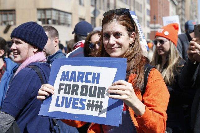 A student holds a sign at the March for Our Lives demonstration in New York City on March 24. Parkland, Fla., students announced a bus tour this summer during which they will encourage Americans to vote in November's midterms. File Photo by John Angelillo/UPI