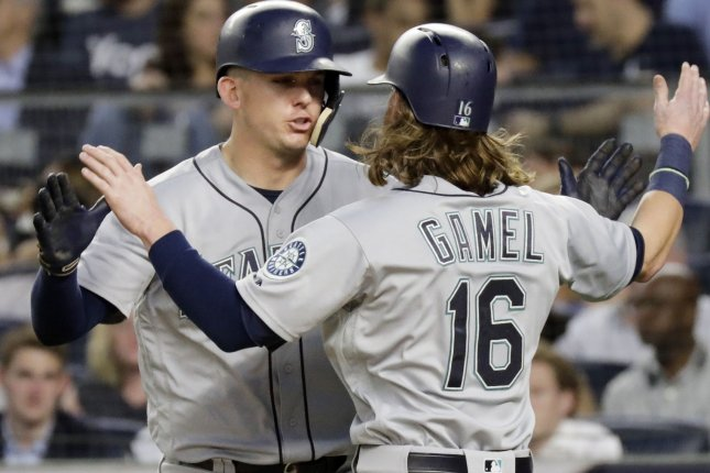 Seattle Mariners' Kyle Seager celebrates at home plate with Ben Gamel after scoring a run in the fourth inning against the New York Yankees on June 20 at Yankee Stadium in New York City. Photo by John Angelillo/UPI