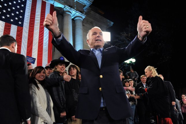 Republican presidential candidate Sen. John McCain and wife, Cindy, greet supporters at a campaign rally on the steps of the old Capitol building in Prescott, Ariz., on November 4, 2008. File Photo by Alexis C. Glenn/UPI