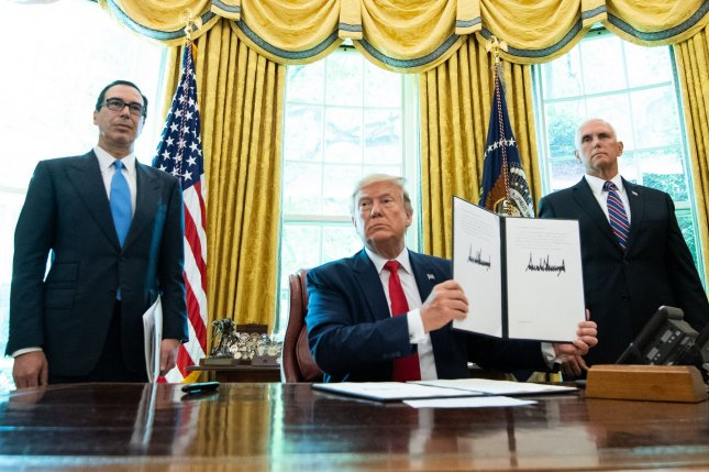 President Donald Trump, joined by Treasury Secretary Steven Mnuchin and Vice President Mike Pence, holds a signed executive order Monday for additional sanctions against Iran. Photo by Kevin Dietsch/UPI