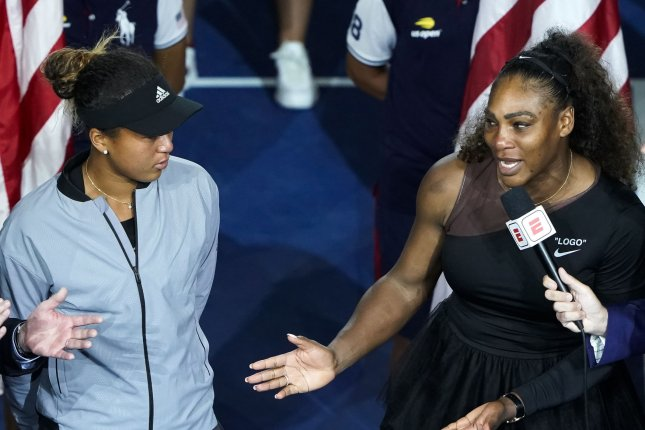 Serena Williams (R) issued an apology to Naomi Osaka (L) for her behavior in last year's U.S. Open final. Williams was given three code violations by chair umpire Carlos Ramos in the match. File Photo by Ray Stubblebine/UPI