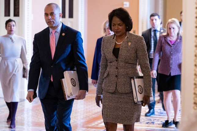 House managers Rep. Hakeem Jeffries, D-N.Y., and Rep. Val Demings, D-Fla., walk into the Senate Chamber for the continuation of the Senate impeachment trial of President Donald Trump at the U.S. Capitol on Wednesday. Photo by Ken Cedeno/UPI
