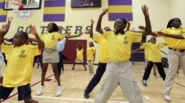 Children from the Barack Obama Elementary School do as many jumping jacks as they can in a one minute period in St. Louis on October 11, 2011. UPI/Bill Greenblatt