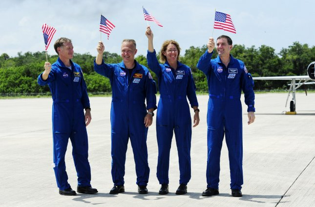 The crew of NASA's space shuttle Atlantis, Commander Chris Ferguson, Pilot Doug Hurley and Mission Specialists Sandra Magnus and Rex Walheim (l to r), arrived to make final preparations for launch at the Kennedy Space Center on July 4, 2011. The crew flew in from Houston and will spend the next three days preparing for mission STS 135. The crew will fly Atlantis to the International Space Station and deliver supplies and equipment during a twelve day mission. STS 135 is the final space shuttle mission for NASA and is planned for launch on July 8 at approximately 11:26 AM. UPI/Joe Marino - Bill Cantrell