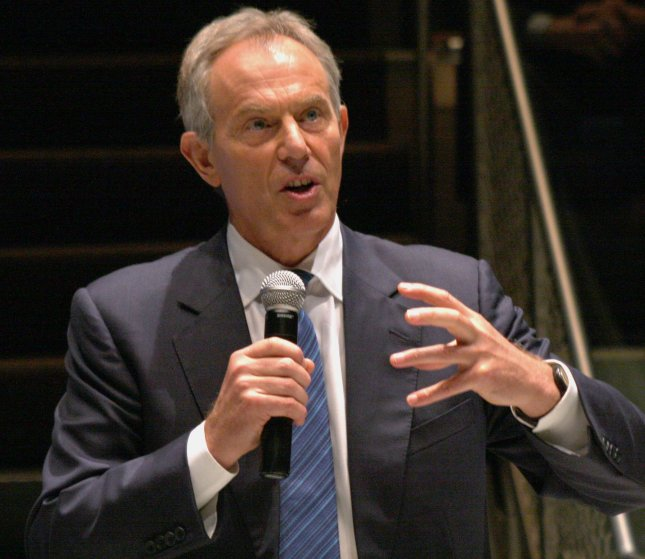 Former British Prime Minister Tony Blair gestures during a conversation with former President Bill Clinton at the National Constitution Center in downtown Philadelphia September 13, 2010. Blair is said to be the victim of blackmail by the Saudis in the midst of bribery allegations. UPI/John Anderson