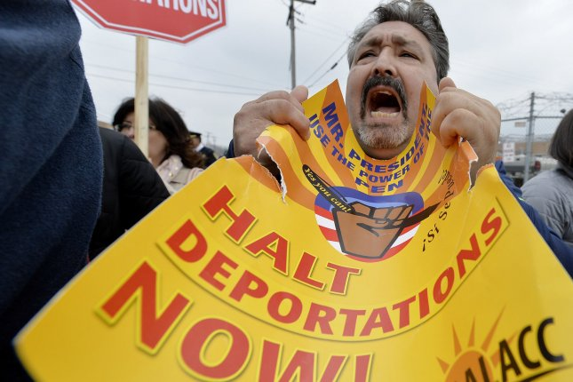 Protestor Marco Puente yells in front of the Immigration and Customs Enforcement detention facility on April 8, 2014 in Broadview, Ill. The protest was the conclusion of a two-day march from ICE's Chicago office to their Broadview detention facility to protest the Obama administration's deportation policy for illegal immigrants. UPI/Brian Kersey
