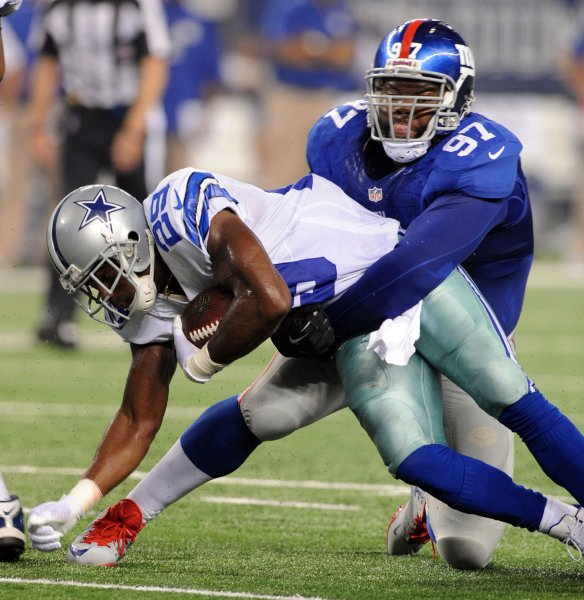 Dallas Cowboys DeMarco Murray gets stopped by New York Giants Linval Joseph during the first half at AT&T Stadium in Arlington, Texas on September 8, 2013. UPI/Ian Halperin