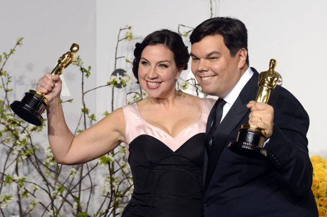 Songwriters Kristen Anderson-Lopez (L) and Robert Lopez hold their awards for Best Achievement in Music Written for Motion Pictures, Original Song 'Let It Go' backstage during the 86th Academy Awards at the Hollywood & Highland Center on March 2, 2014 in Los Angeles. Photo by Phil McCarten/UPI
