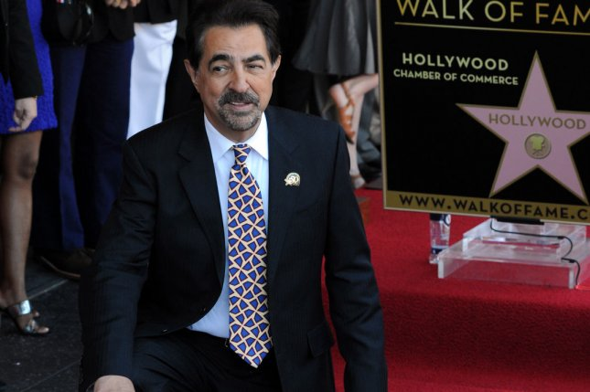 Actor Joe Mantegna holds a replica plaque during an unveiling ceremony honoring him with the 2,438th star of the Hollywood Walk of Fame in Los Angeles on April 29, 2011. CBS has renewed his show Criminal Minds for a 13th season. File Photo by Jim Ruymen/UPI